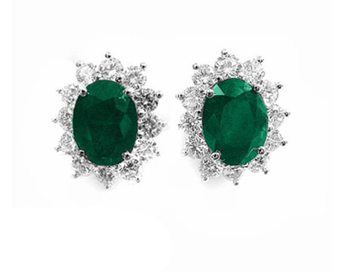OVAL EMERALD AND ROUND DIAMOND CLUSTER STUD EARRINGSPictured item: emerald 2.30ct/diamond 0.95ct set in 18k white goldimage 2310