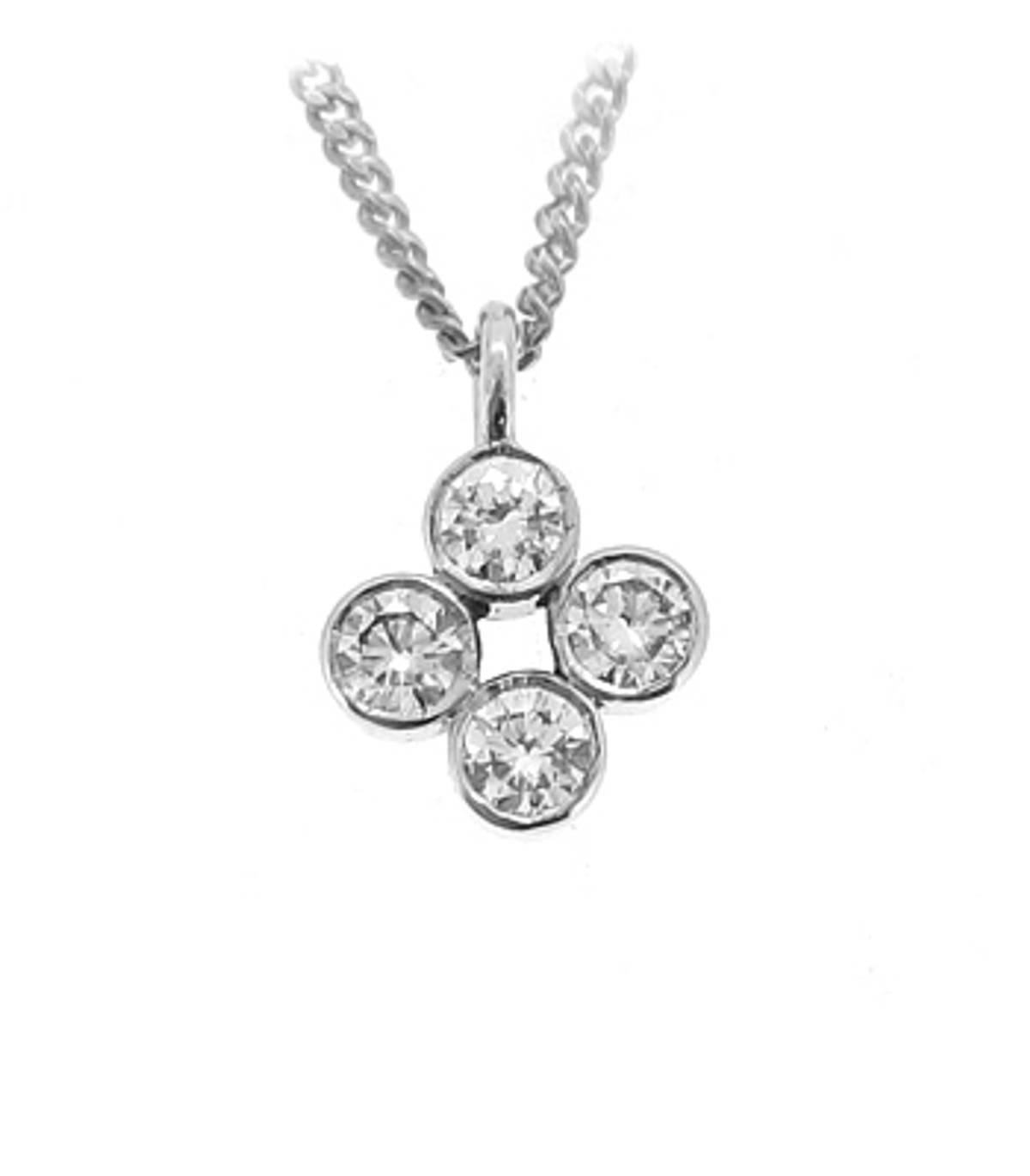 "18ct white gold 4 stone brilliant cut diamond pendant with ""rub over"" setting.  Diamond Cut: Brilliant Setting: Rub Over Setting Chain: 18k white gold 18 inch chain Carat: Total diamond weight 0.45 carats Pendant Size: 13mm x 9mm"