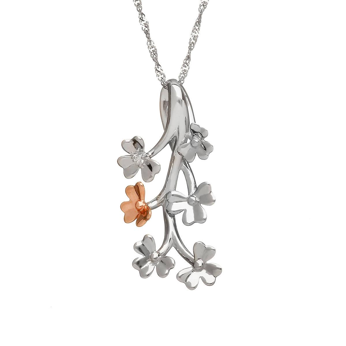 diamond set 9 carat white gold love shamrock spray pendant with one rare Irish rose gold flower.