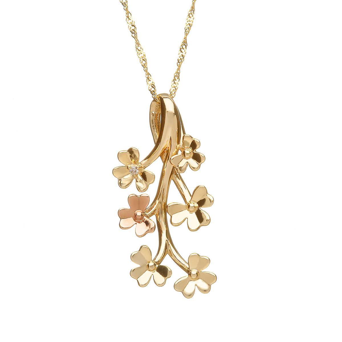 diamond set 9 carat yellow gold love shamrock spray pendant with one rare Irish rose gold flower.