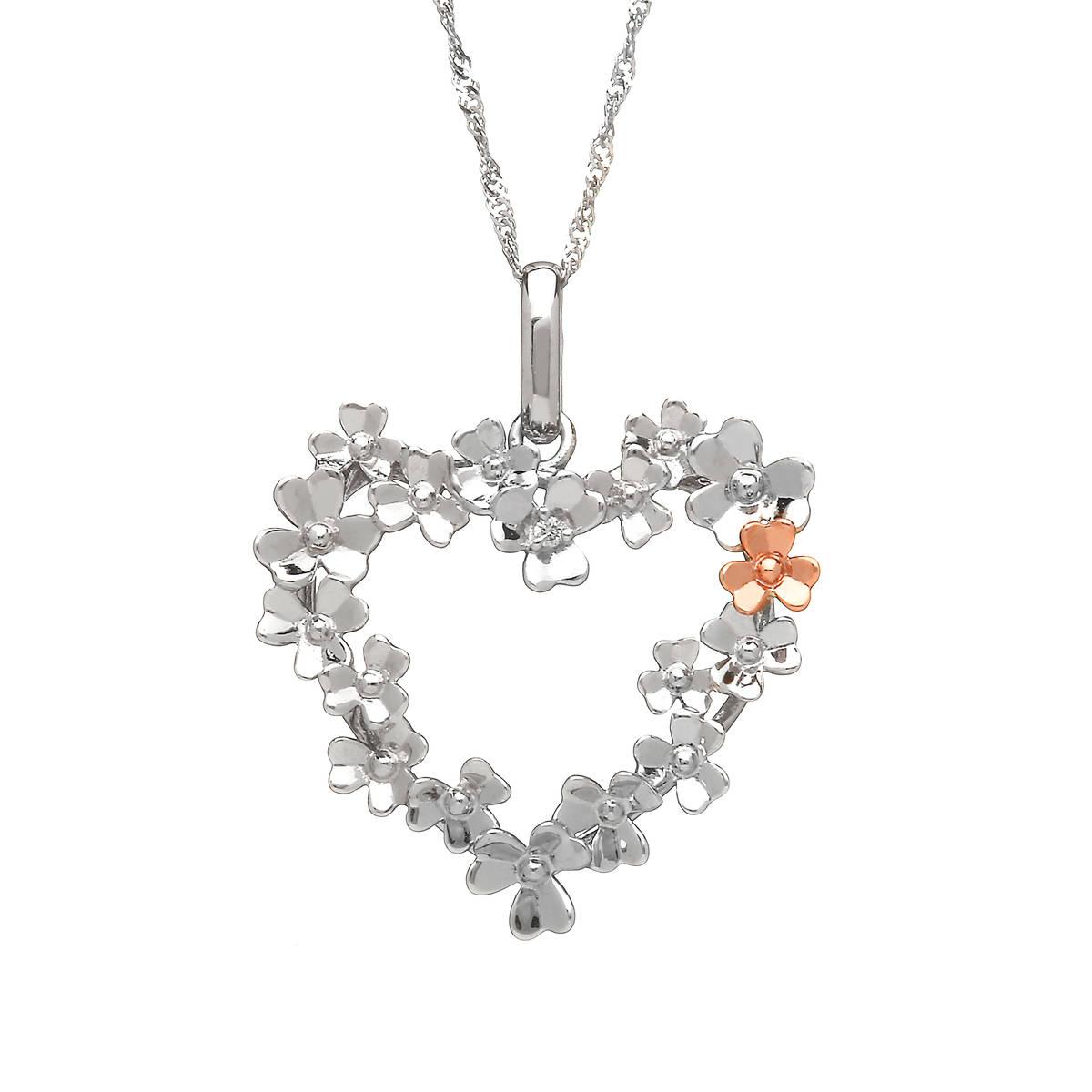diamond set 9 carat white gold love shamrock large open heart wreath pendant with one rare Irish rose gold flower.