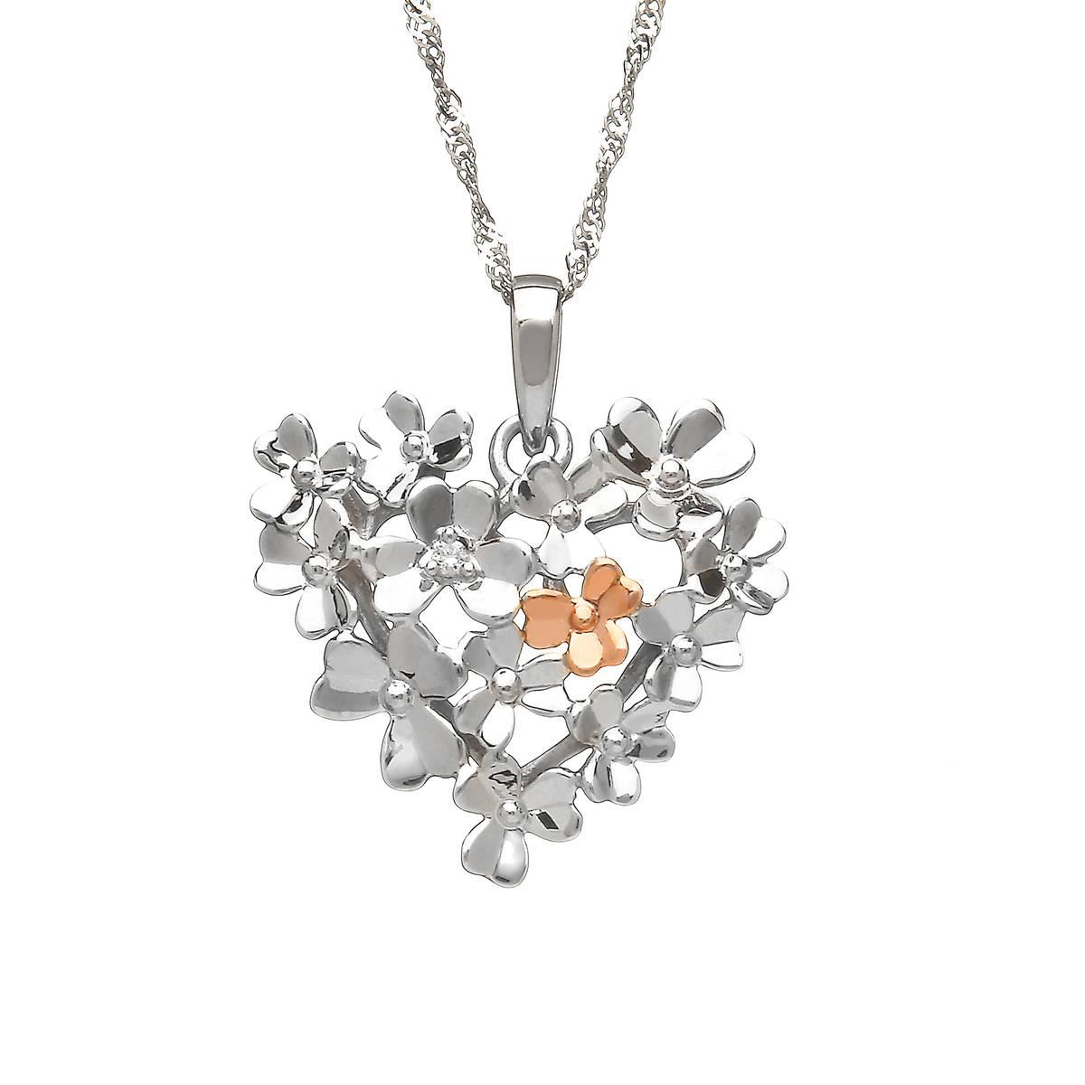 diamond set 9 carat white gold love shamrock large heart bouquet pendant with one rare Irish rose gold flower.
