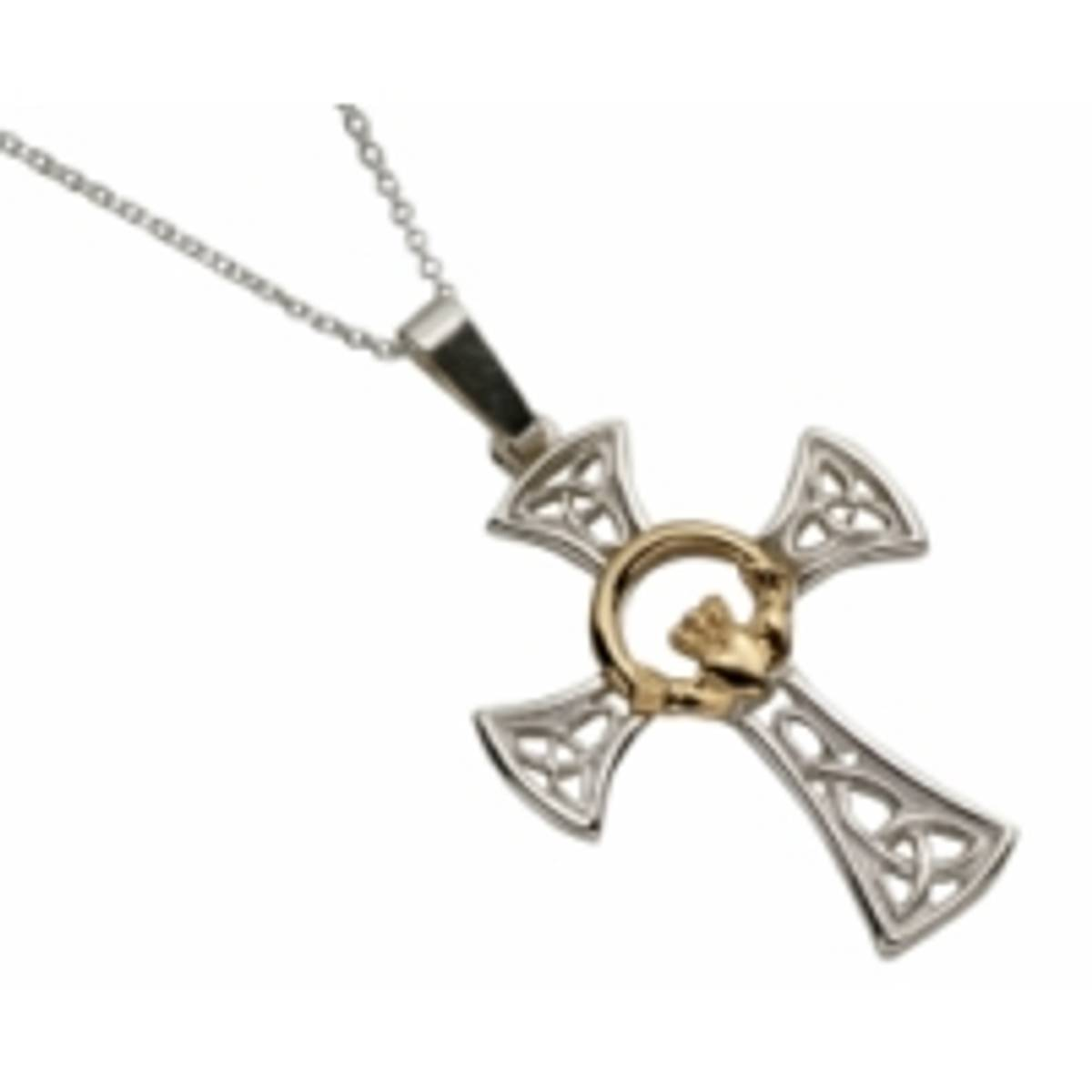 Silver filigree Celtic cross pendant with 10 carat yellow gold Claddagh motif.