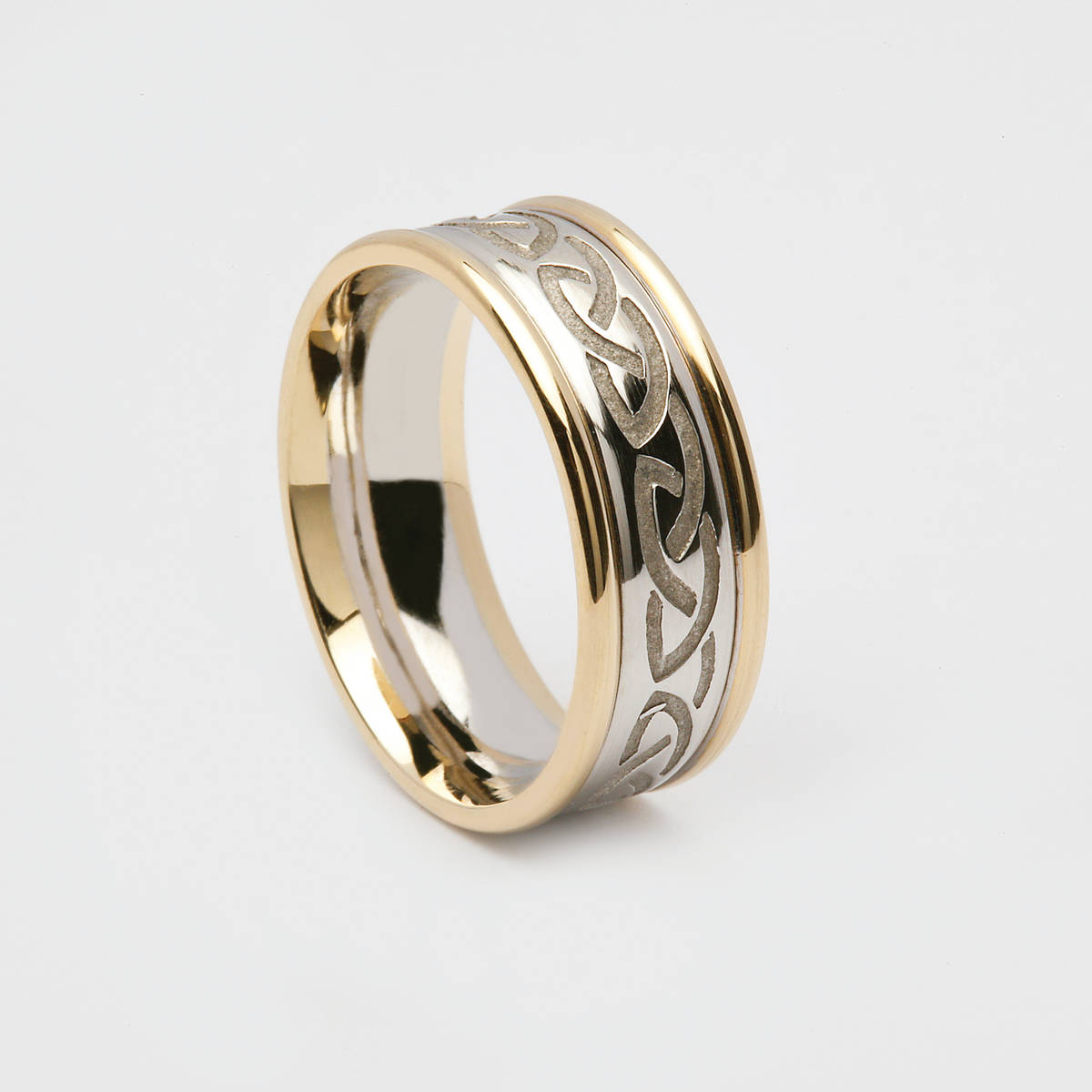 10ct gold Gents Wedding Band with heavy recessed white gold Celtic Knot design centre and yellow gold heavy rims.  Width: 8.7mm Profile: D Shape. (Flat on the inside with a distinctive, domed outside.)