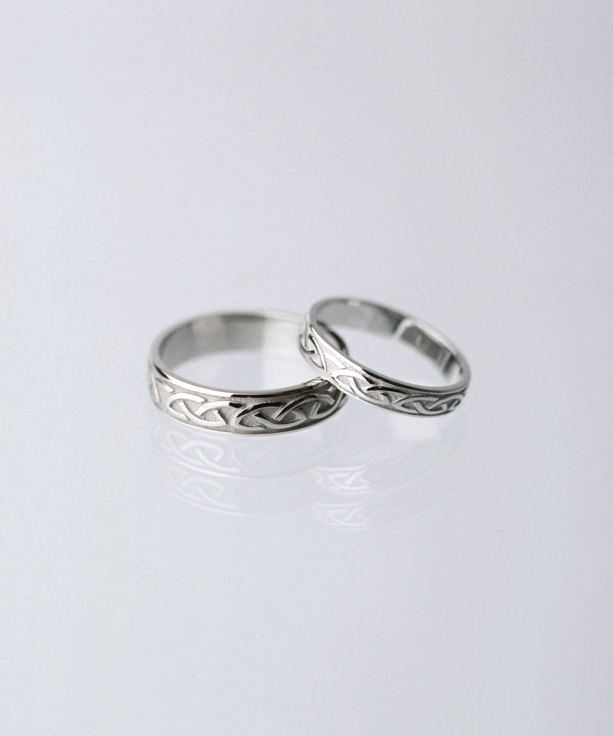 18 carat white gold man's Celtic love knot ring 3.6mmPlease note the man's ring is on the left.