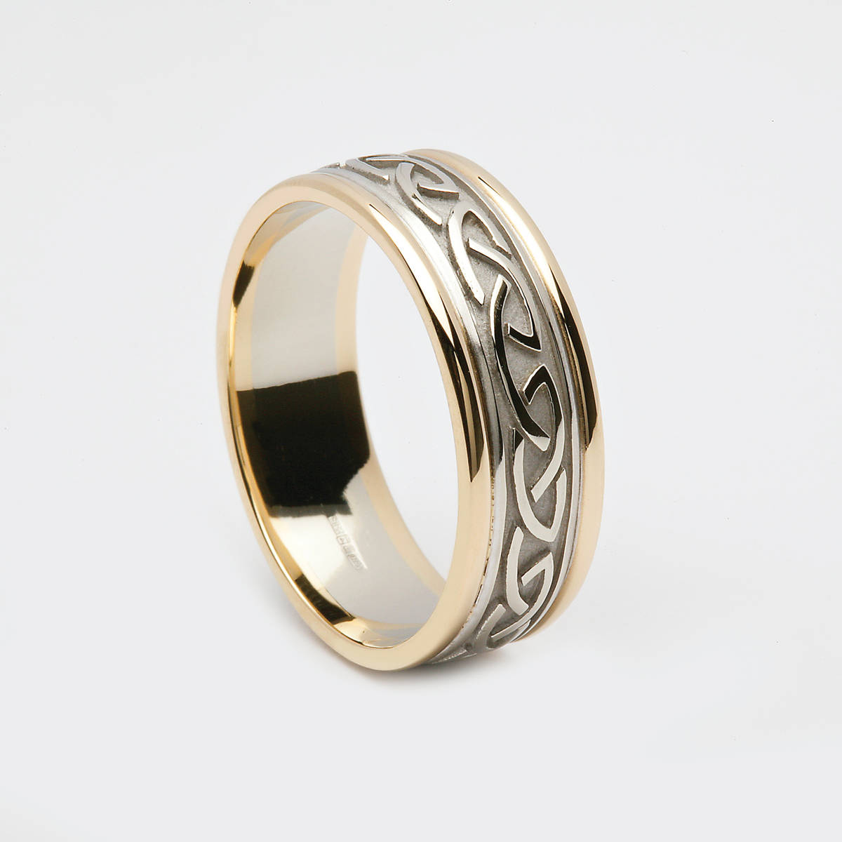 "14ct white gold unisex 7mm wide Celtic Love Knot wedding band, with heavy raised Celtic knot embossed centre, with yellow gold ""light"" rims for added comfort. Universal fit.  If you desire rose gold rims or any other change , just leave your instruction in the comment box on the checkout page."