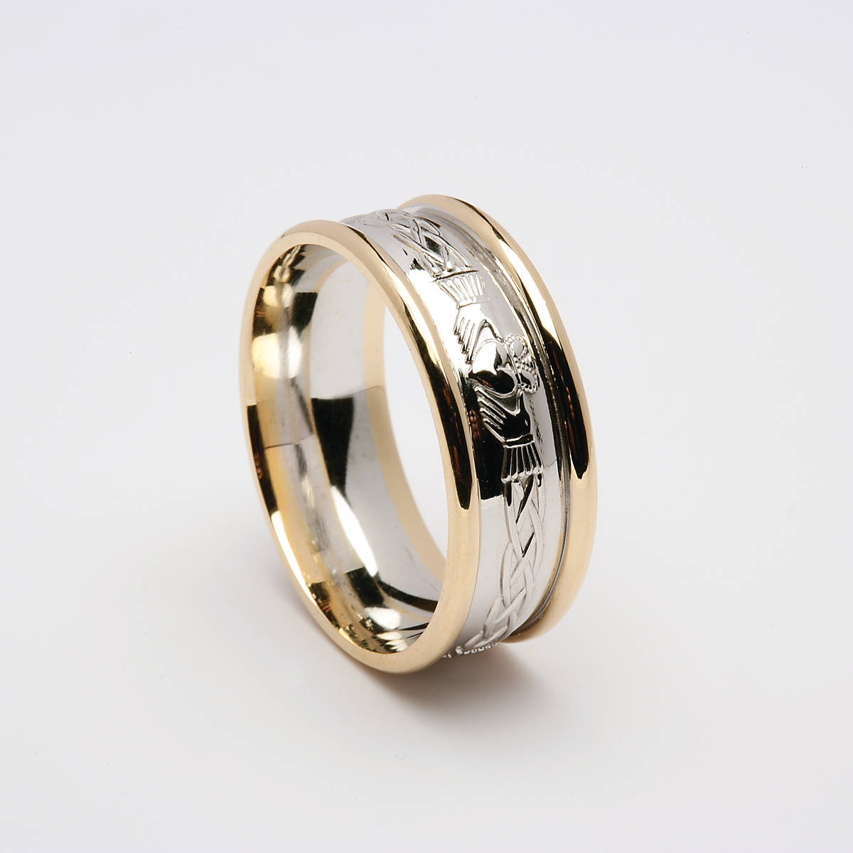 14 carat white gold man's Celtic Claddagh wedding ring with Heavy yellow gold rims.A very comfortable ring to wear and very beautiful. 8.7mm wide