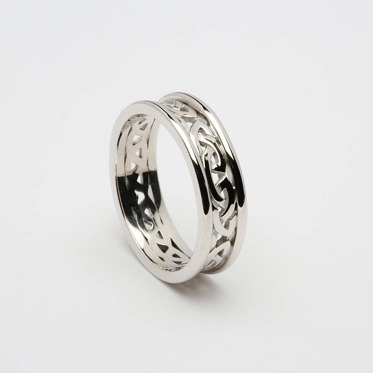 14ct white gold ladies Celtic Open Knot wedding ring with heavy 14ct white gold rims.  Width: 6.1 mm