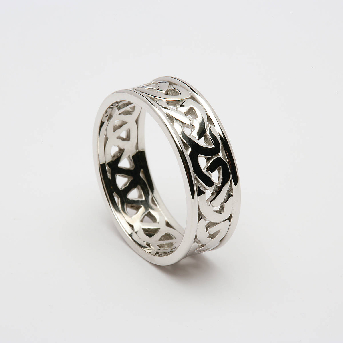 14 carat white gold unisex Celtic open knot wedding ring with light 14 carat white gold rims.7.3mm