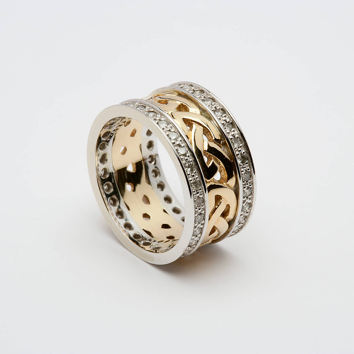 10ct yellow gold ladies open Celtic Knot wedding band with white gold heavy outer rims set with diamonds.  Width: 9.5 mm