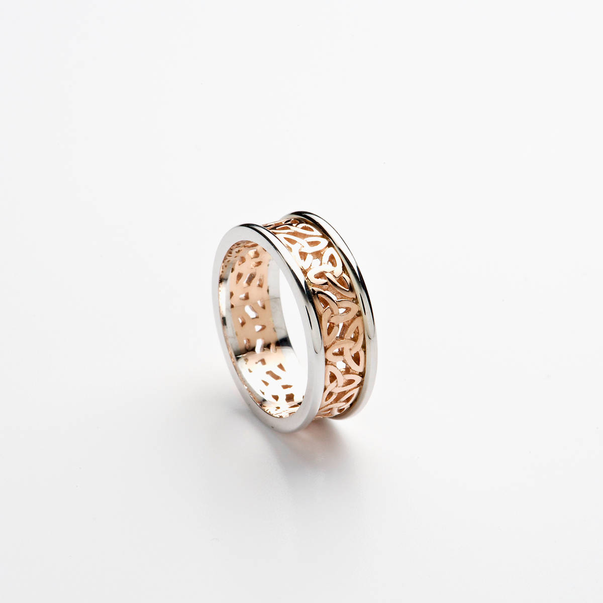 14ct rose gold ladies wedding band with light rose gold open Trinity Knot centre, and white gold heavy rims.  Width: 7.2 mm Profile: D-Shape