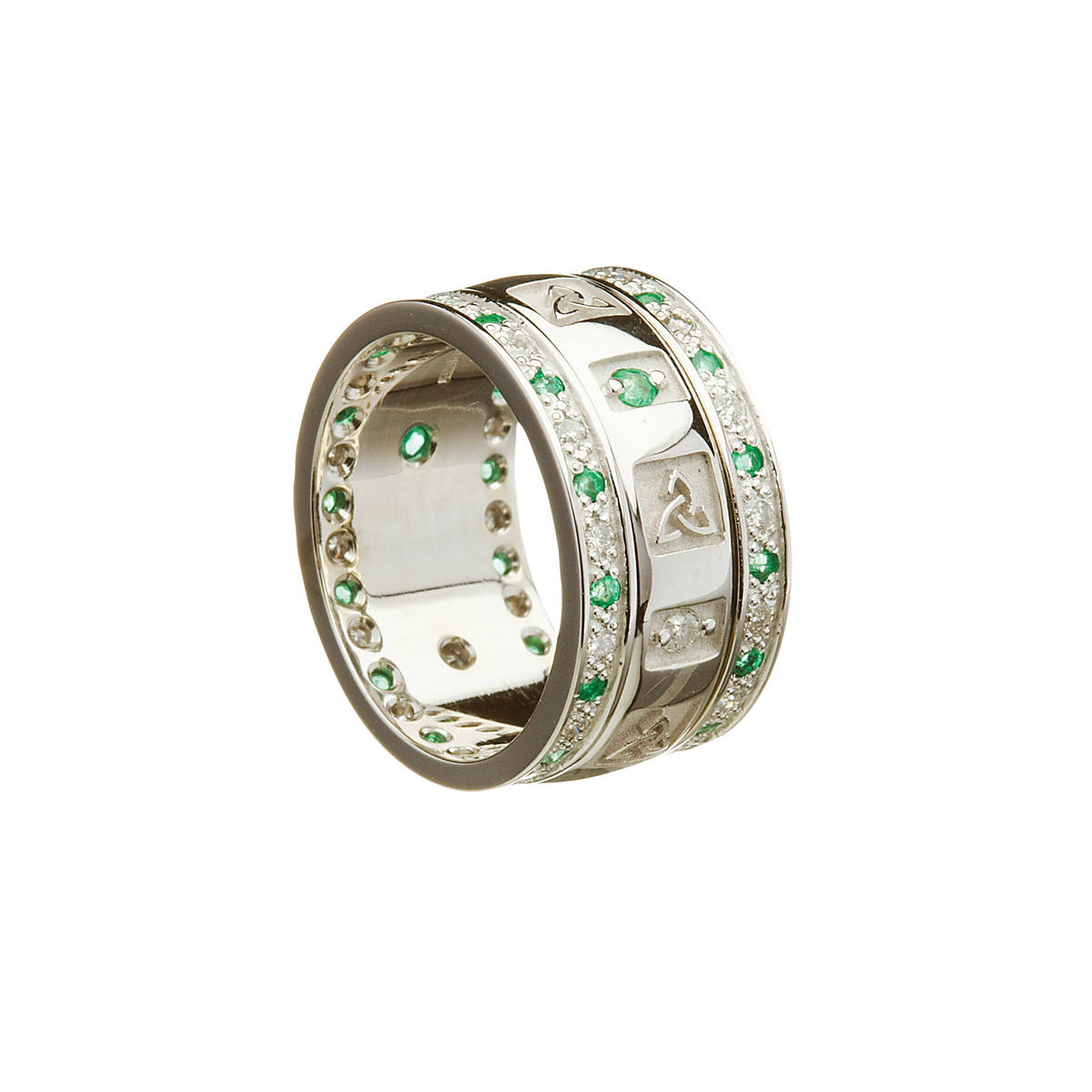 14ct white gold ladies wedding band with Celtic Trinity Knot windows and alternating diamonds and emeralds. Rims channel-set diamonds and emeralds.   Centre contains 3 diamonds and 3 emeralds and heavy raised Celtic Trinity Knot windows.   Rim channel-set with diamonds and emeralds also.  Width: 8.3 mm