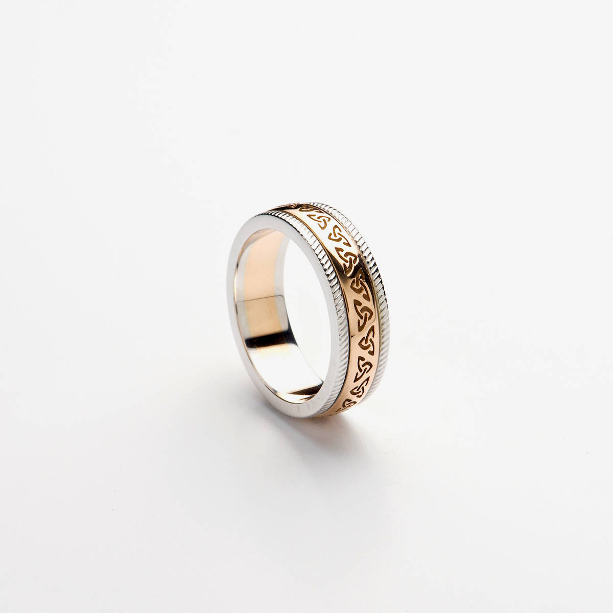 14ct rose gold wedding band with rose gold recessed Trinity Knot Design centre and heavy white gold rims.  Profile: D-Shape  Note: This ring has a rose gold centre, not yellow gold as in the image. Available in yellow gold also upon request.