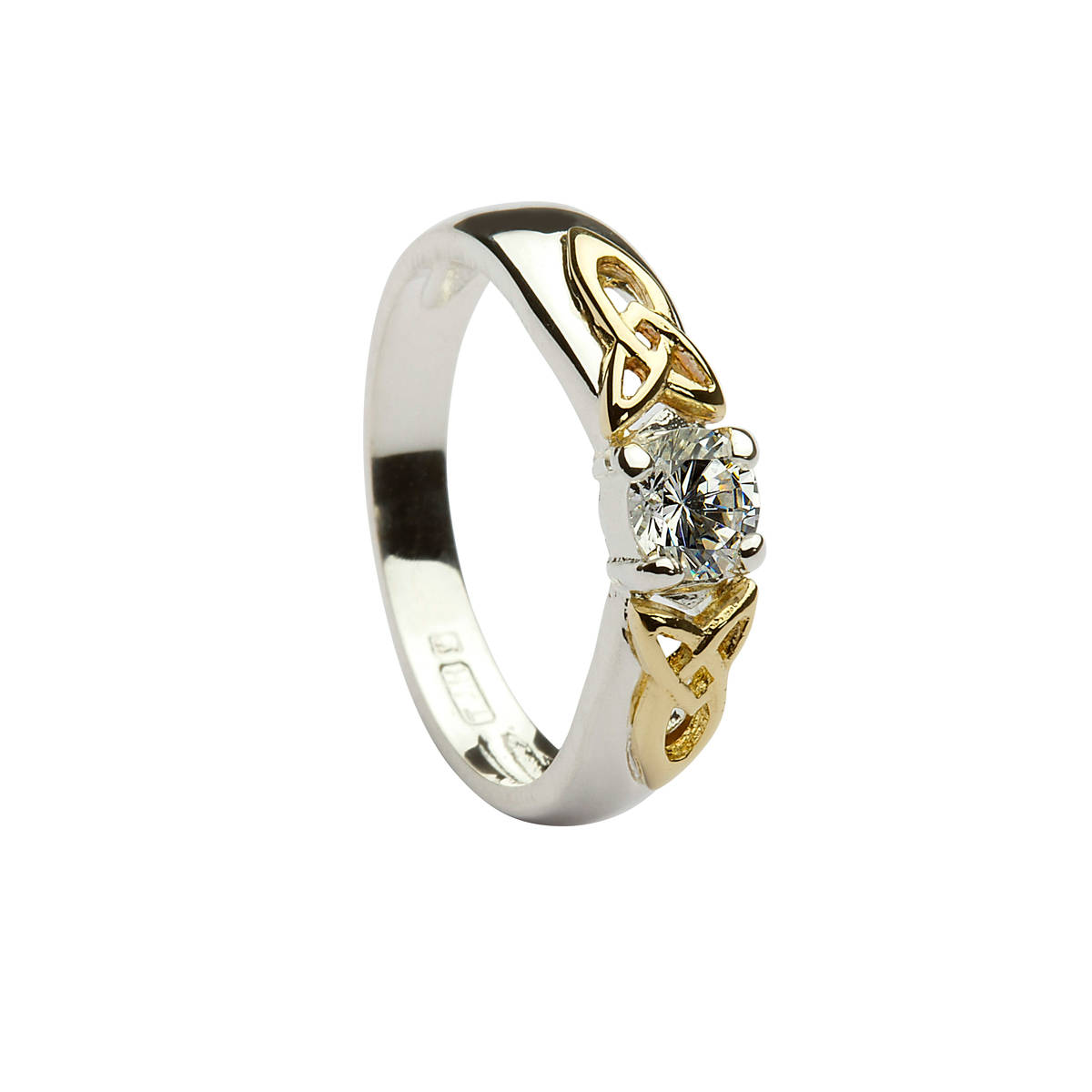 Silver ring with 10 carat yellow gold celtic knot style shoulders with cubic zirconia solitaire stone mounted dress ring