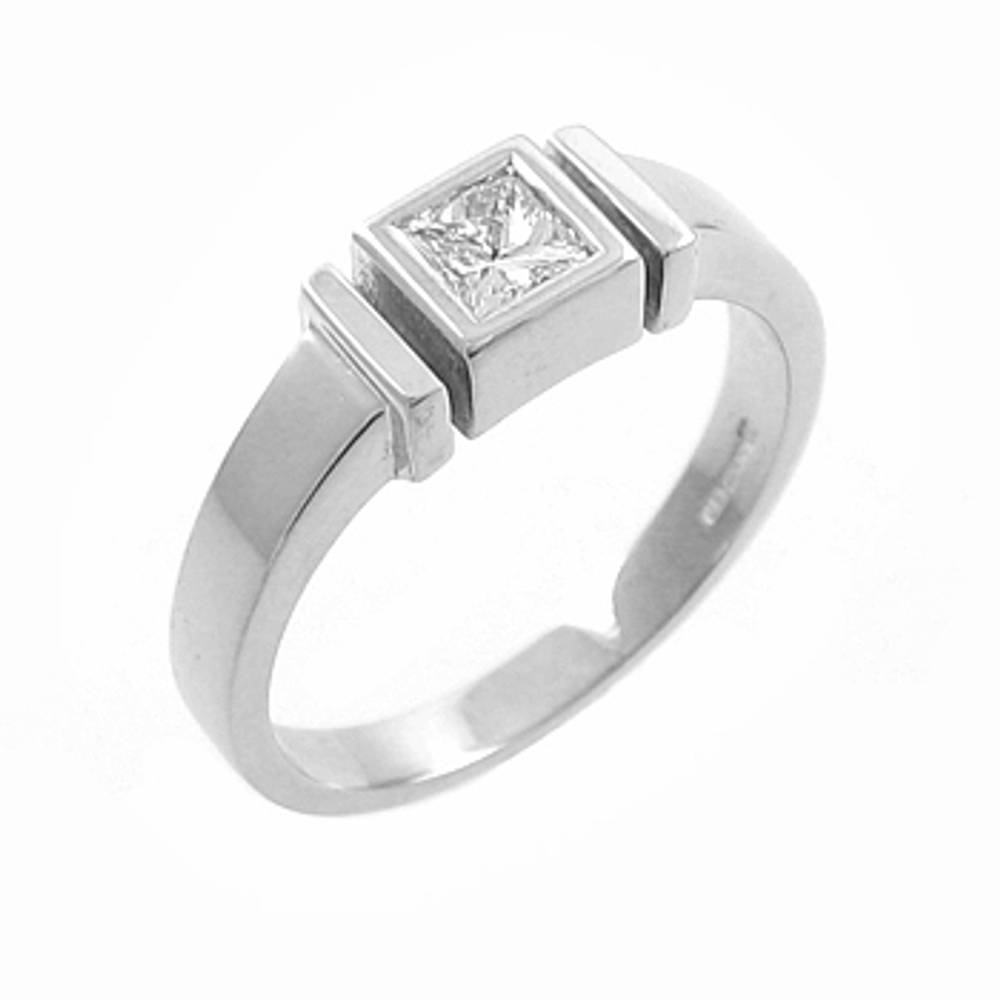 Princess cut diamond rubover set solitaire ring in 18 ct white gold