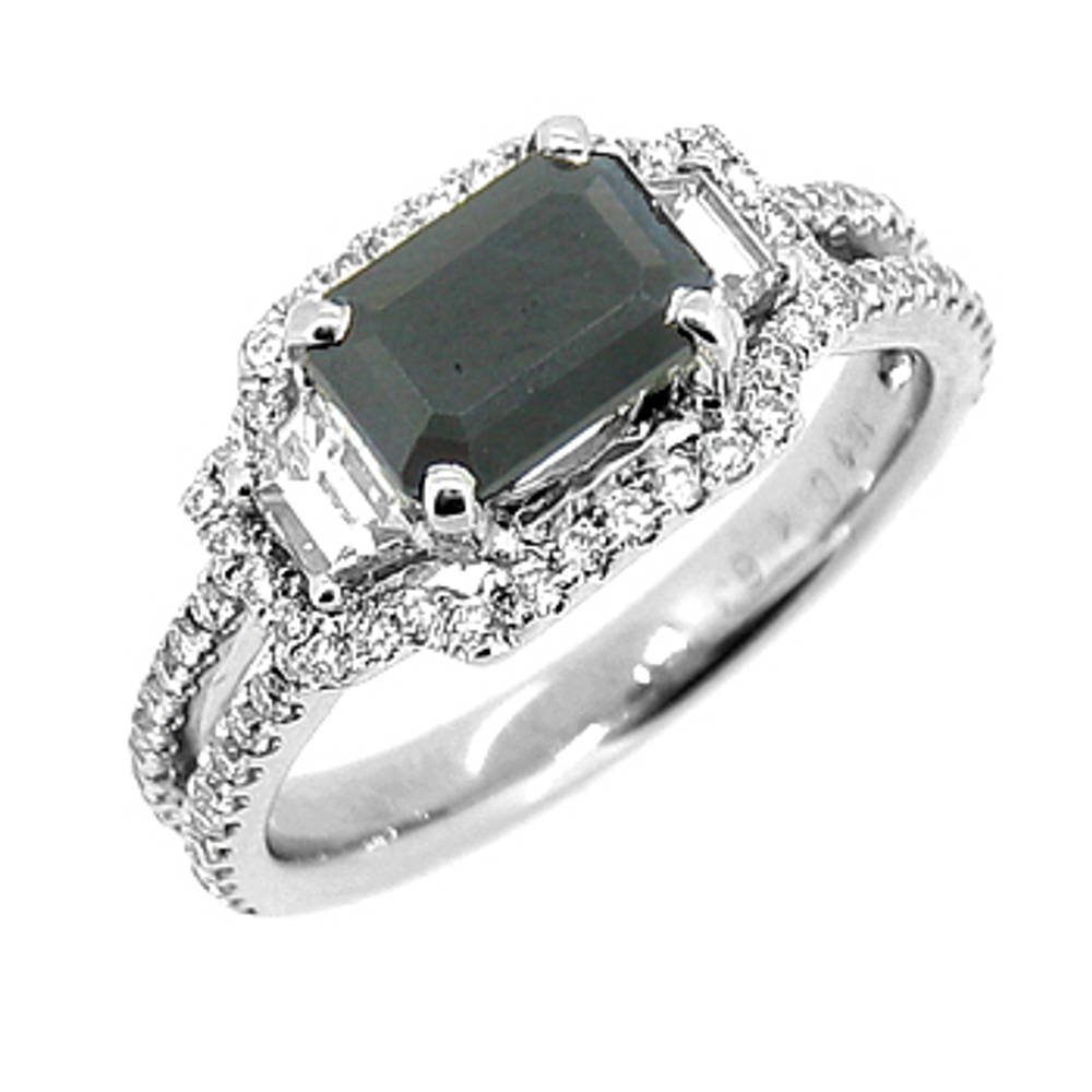 Dark sapphire and diamond cluster ring in 18 ct white gold