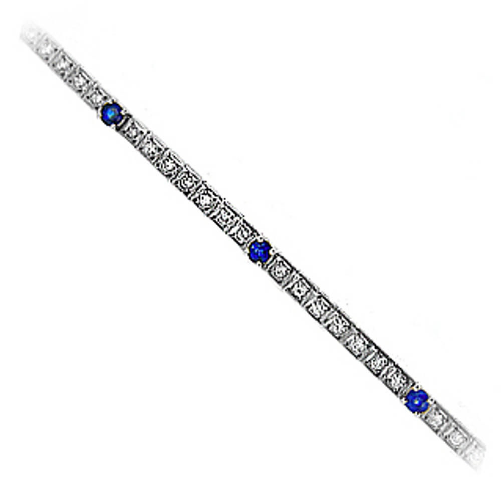 Sapphire and diamond line bracelet in 18 ct white gold