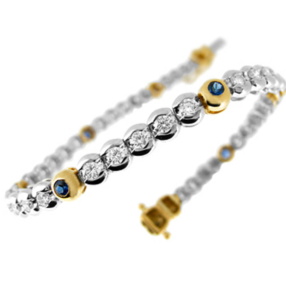 Sapphire and diamond rubover set line bracelet in 18 ct yellow/white gold