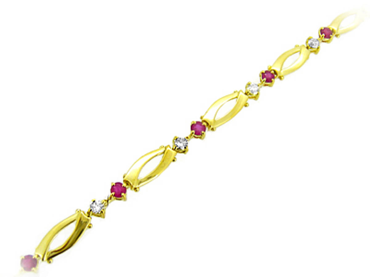 Ruby and diamond braceletAvailable in: 18k goldPictured item: 0.80cts brilliant cut diamonds/1.28cts ruby set in 18k yellow gold