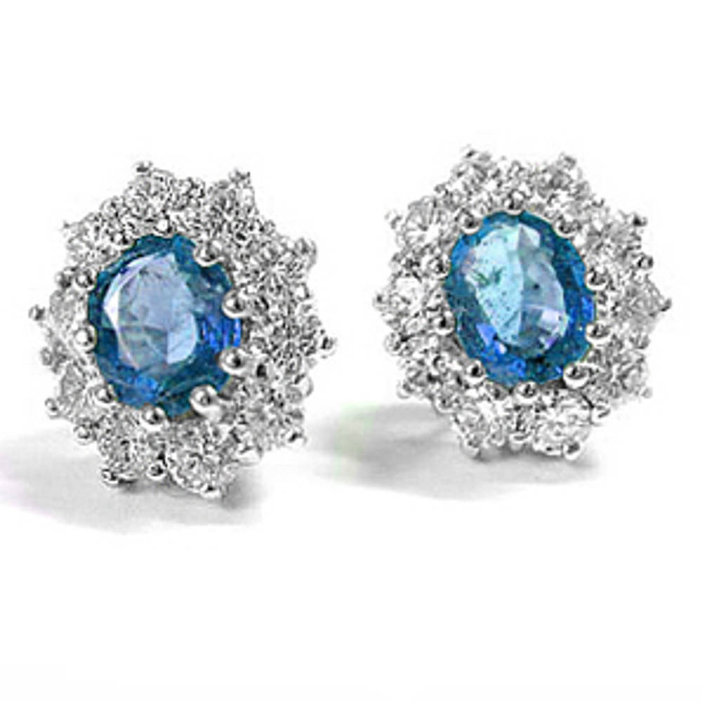 Oval sapphire and round diamond cluster stud earrings in 18 ct white gold