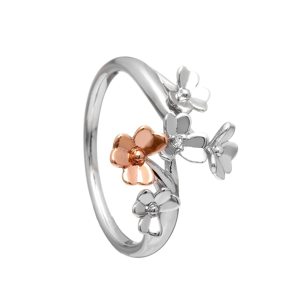 Diamond set 9 carat white gold love shamrock spray ring with one rare Irish rose gold flower. An elegant floral ring distinctly recognisable as Irish.