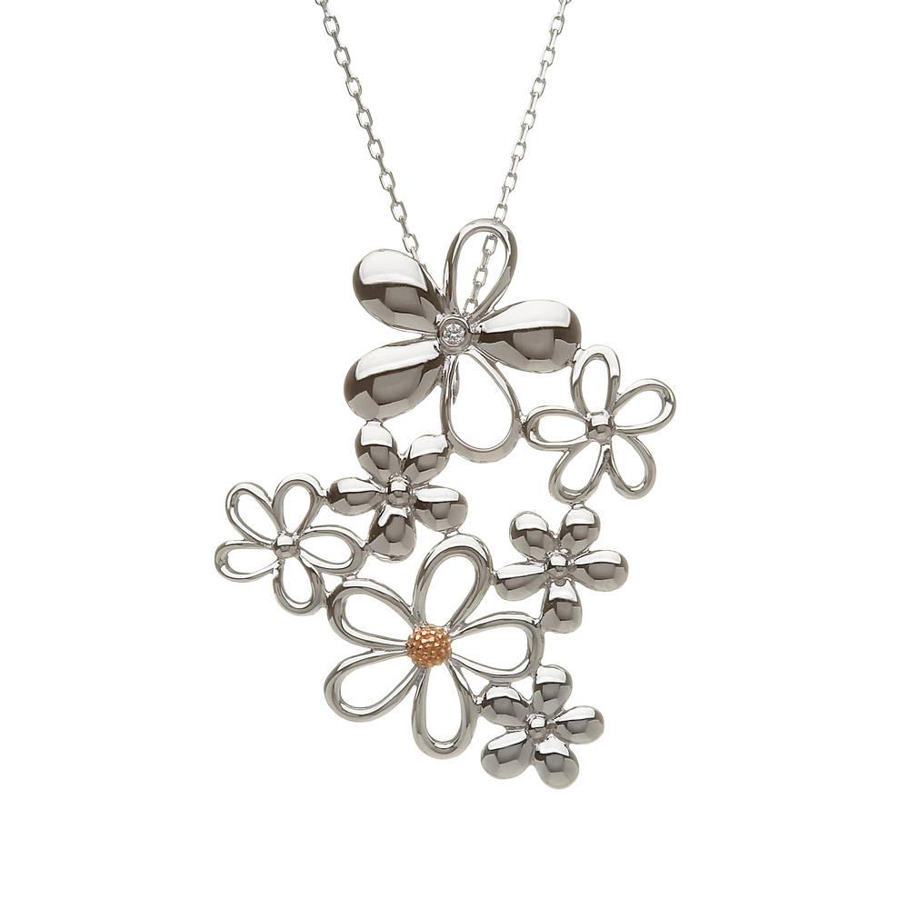silver and gold diamond set petal pendant with rare Irish gold