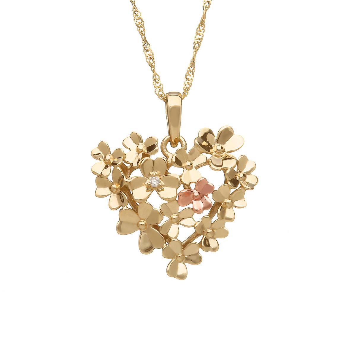 silver and rose gold love diamond set shamrock pendant
