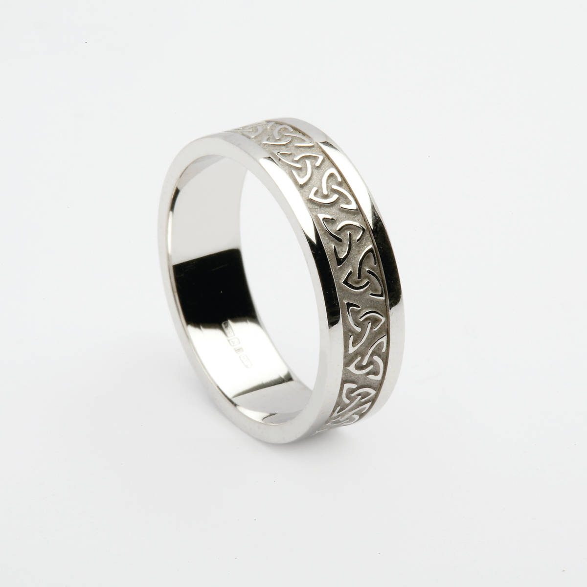 A very distinctive 18 carat white gold man's raised Celtic knot repeating design wedding ring.Also very comfortable to wear.
