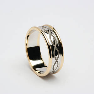 10 carat white gold and yellow gold man's  ring with two lines entwined.