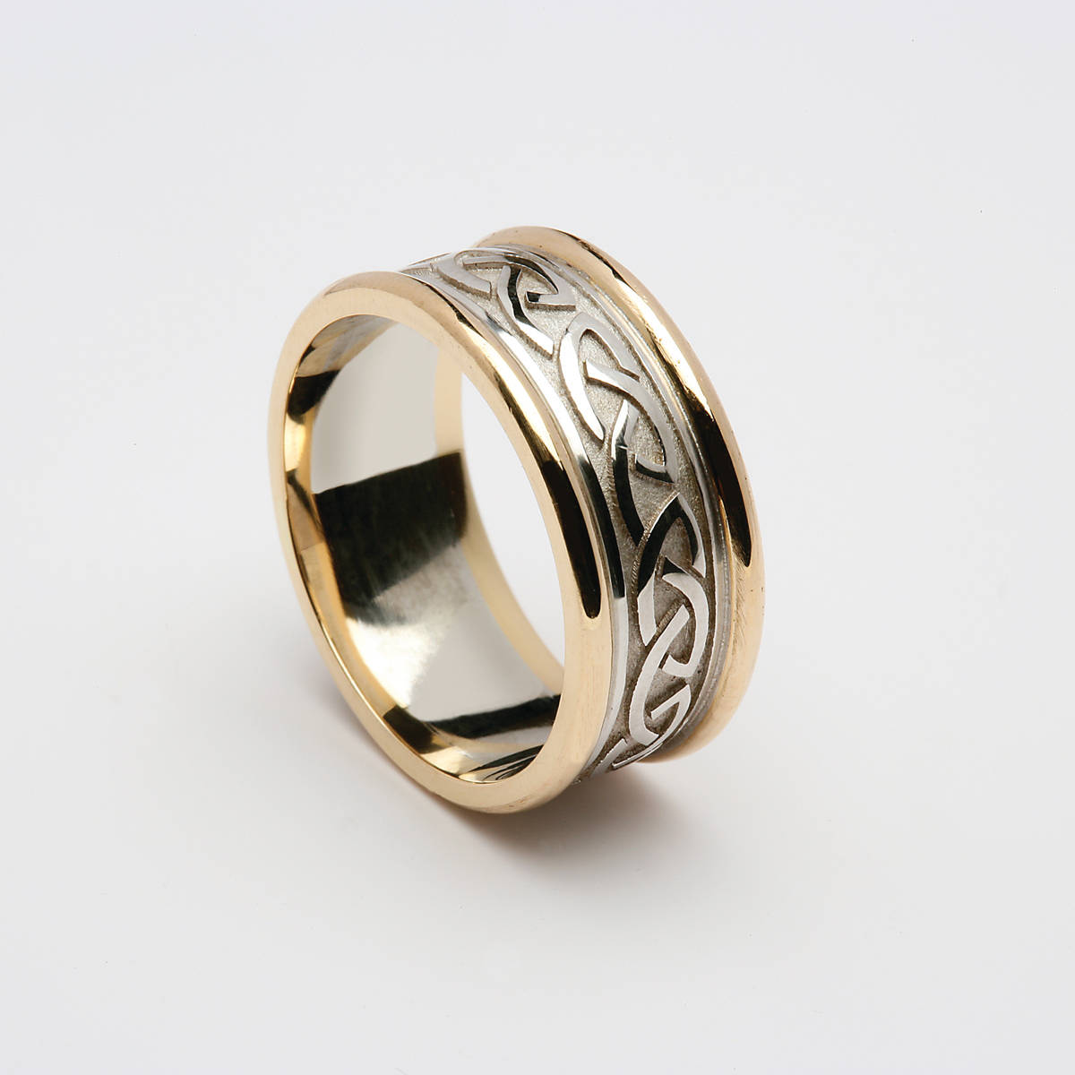 10 carat white gold man's Celtic love knot wedding ring with yellow gold rims.7mmVery beautiful.
