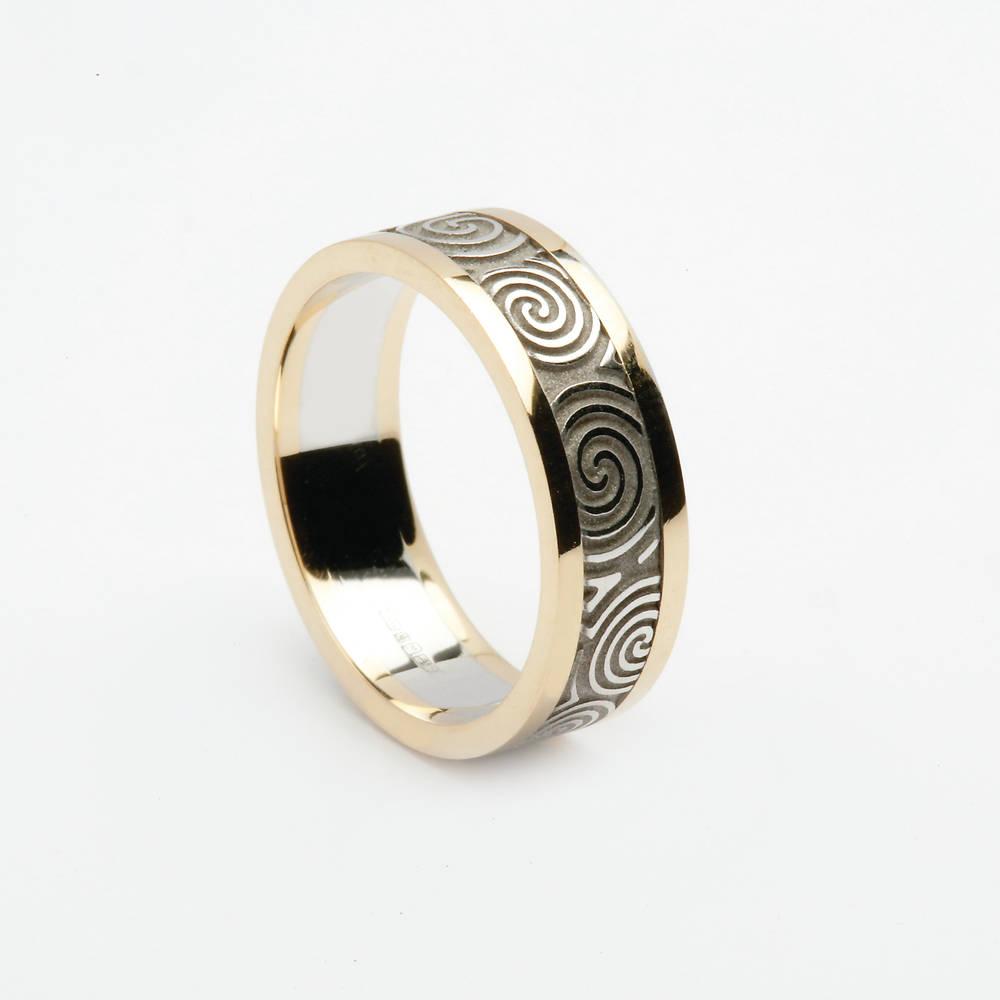 14 carat white gold man's New Grange ring with yellow gold rims