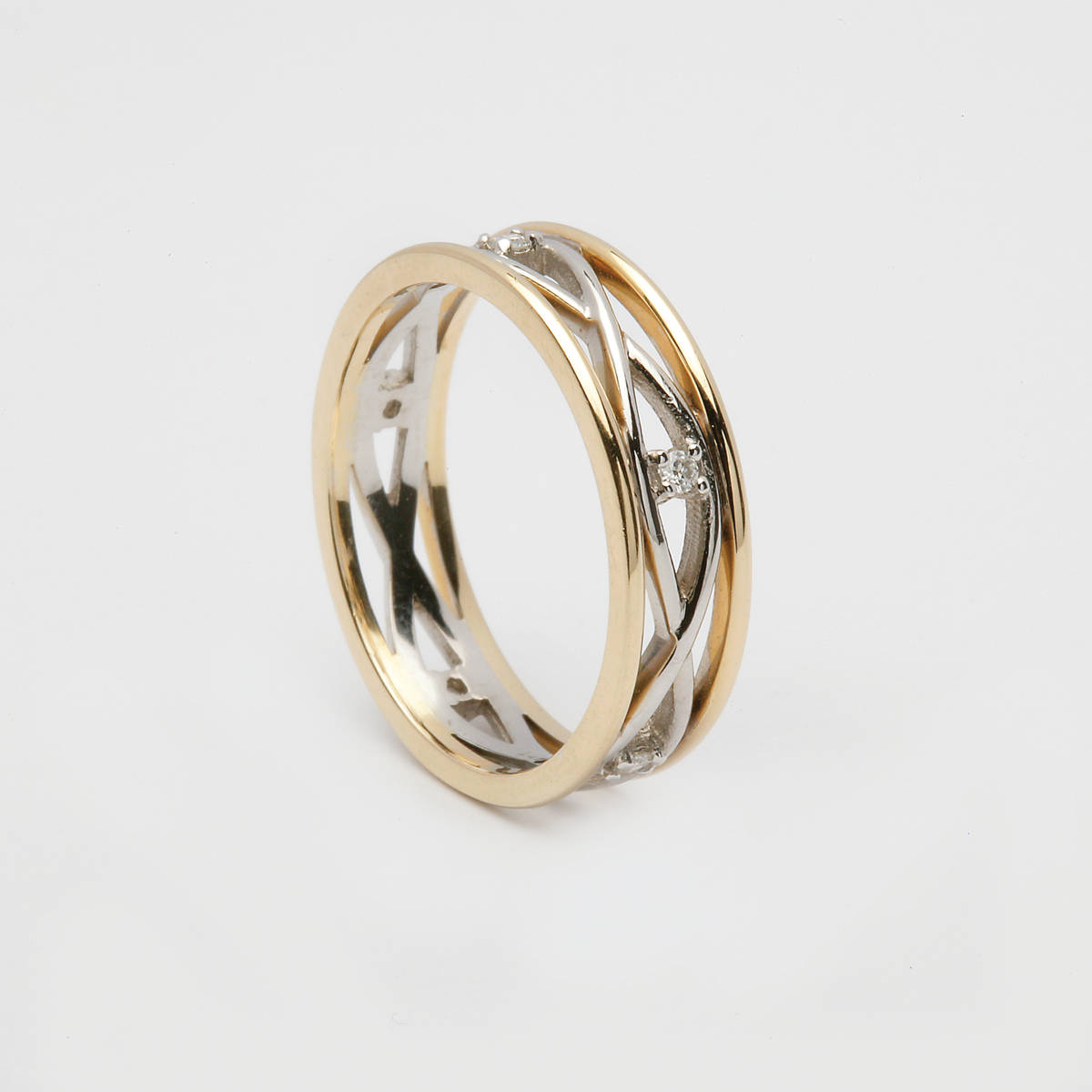 18 carat white gold lady's two lines entwined Celtic wedding ring with yellow gold shoulders and set with diamonds.