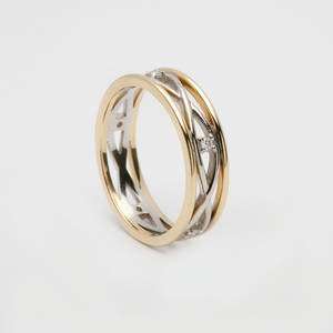 14 carat white gold lady's Celtic woven wedding ring with yellow gold rims and diamonds