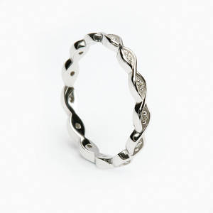 14 carat white gold lady's two lines entwined wedding ring with 0.10 diamonds.