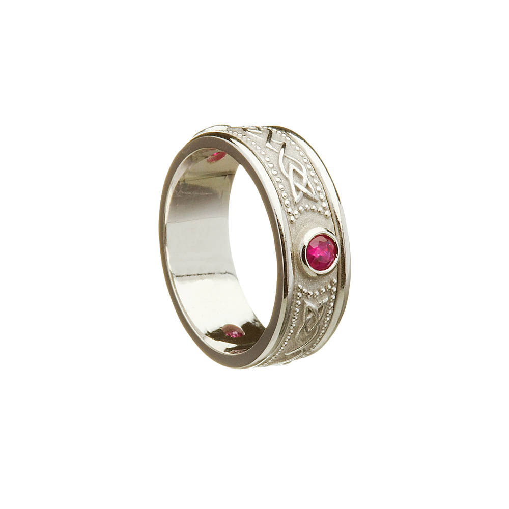 14 carat white gold lady's celtic warrior ring with rubies.
