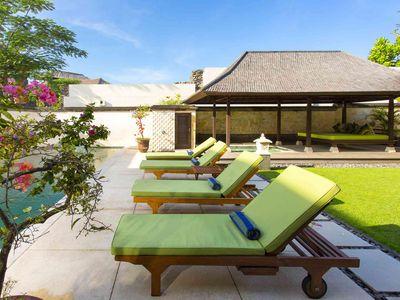 Bayu Gita Residence - Poolside deck chairs