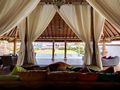Majapahit Beach Villas - Maya Joglo - Bridal suite living view of pool and garden