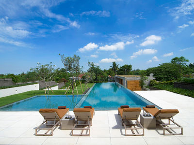 The Iman Villa - Sunloungers by the pool