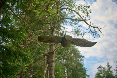 A wooden sculpture in mountain forest