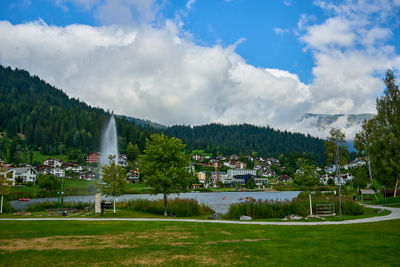 Mountain lake and a fountain in Laax, Swiss Alps