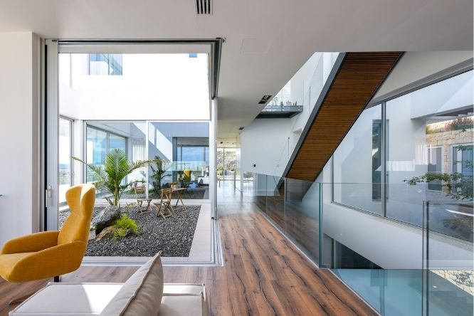 luxury modern villa house design - sliding glass doors and frameless glass balustrade