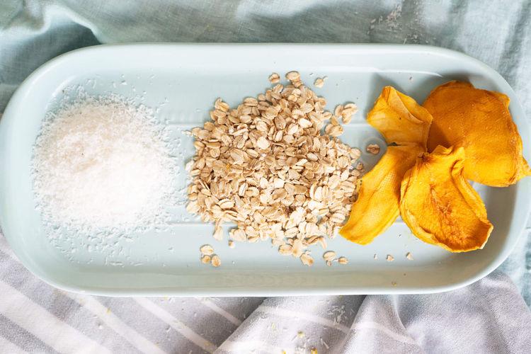 Coconut flakes, oats, mango