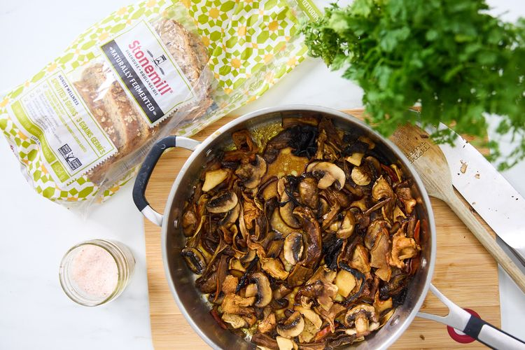 Mushrooms on a pan with a loaf of bread