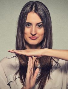 Resilient woman making time out hand signal