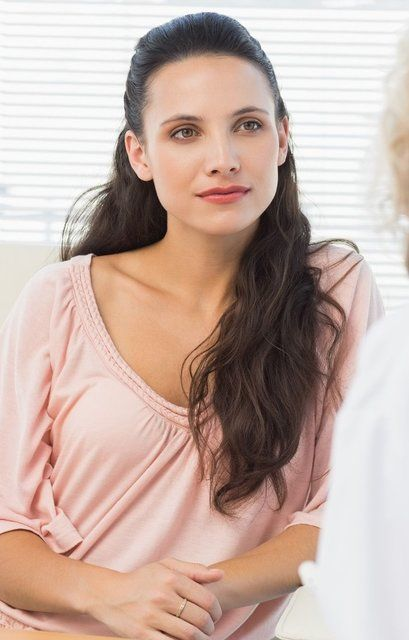 Woman receiving consultation in a doctor's office