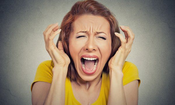 Woman screaming due to stress