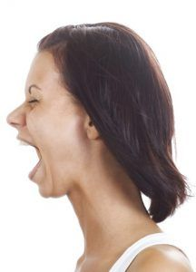 Woman screaming due to stress from menopause