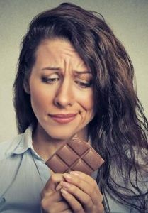 Woman struggling with chocolate cravings