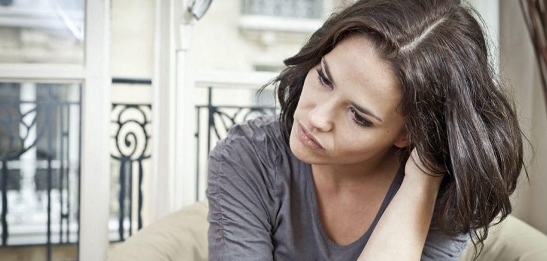Pensive looking dark hair woman