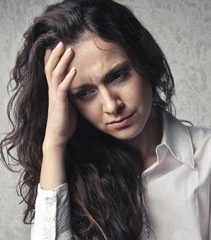 Upset dark haired woman